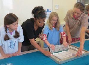 Pupils from The Christain School  and parent working with artist Kiran Chahal